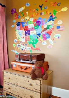 Oh Say Can You See - canvas wall stickers that are removable and repositionable.  Can be personalized.  We have ours in the playroom and mark with arrows where we've been and where we're going.