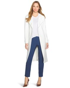 "The embodiment of city style, our soft trench coat drapes like a dream. Gilded buttons accent its requisite epaulettes and it's equipped with an optional self belt. In ethereal white, we have deemed this lightweight topper a must-have for spring, especially when paired with brightly hued pants.   Soft trench coat  Fully lined   Polyester/spandex. Machine wash, cold.   Regular: Approx. 44.5"" from shoulder  Petite: Approx. 43.5"" from shoulder  Imported"