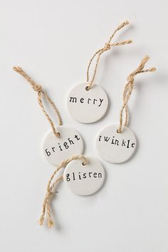 "Ceramic gift tags- Make home home instead use Sculpy clay (original white) roll out 1/8"" thick, cut small circles and stamp with tiny letter rubber stamps! Bake then wipe watered down dark paint over the letters and buff off the main surface. Tie with baker's twine or jute and there you have it!"