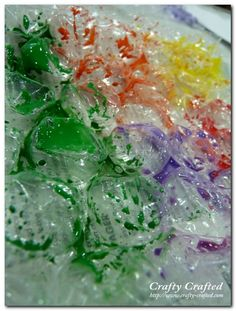 Abstract bubble wrap art...  We did this in my Art class.  So much fun and not too messy!