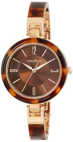 Caravelle New York Women's Analog Display Japanese Quartz Watch. Alloy case and plastic bangle. Water resistant to 99 feet M): withstands rain and splashes of water, but not showering or submersion. Bulova Watches, Luxury Watches, Quartz Watch, Fashion Watches, Michael Kors Watch, Gold Watch, Wrist Watches, Image Link, Japanese