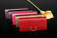 http://www.aliexpress.com/store/product/2014-NEW-fashion-japanned-leather-women-s-long-design-wallets-women-wallets-genuine-leather-Day-clutches/222612_890863903.html