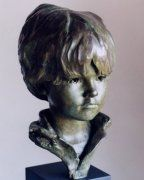commissioned sculpture of a boy in bronze