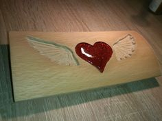 Self-made wooden ornament with resin heart. This one is not yet finished. It is made of oak wood and resin of spruces from forest.