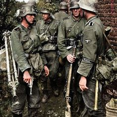 """the_ww2_memoirs Waffen SS soldiers with """"Germania"""" cuffs on their uniforms belonging to the 5th SS Panzer Divison """"Wiking"""", take a break during a lull in the fighting after advancing miles during Operation Barbarossa, 1941. The date and location were unknown before but I did research and I've pinpointed the date and what operation and if you research further you can probably pinpoint where. If you look at their tunics they're wearing model 1936 tunics and one has a Luger P08 pistol which…"""