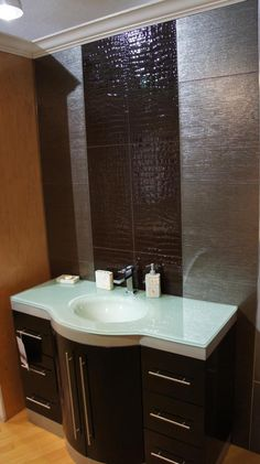 modern bathroom vanity with glass top. Croco brown tile used as an accent on the wall and accomplished by shinny silver tile. http://www.bauformatusa.com