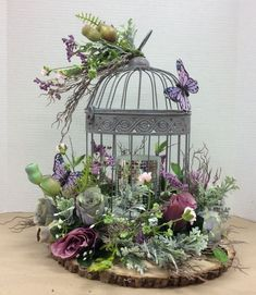 Floral design I made using wire bird cage glued to foam that was glued to log slab. Added a painted thin wood circle inside cage to cover glue. Added LED candle with mirror tiles inside cage. Bird Cage Centerpiece, Deco Floral, Floral Foam, Vintage Floral, Vintage Birds, Wood Circles, Bird Houses, Wedding Centerpieces, Flower Centerpieces