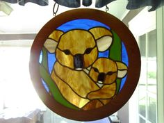 Stained glass koala bear with baby.