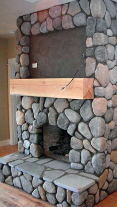 River rock fireplace i kind of like the big rocks for the dining river rock real wood burning fireplace with space for tv above mantle solutioingenieria