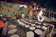 Volunteer making roti in golden temple langar