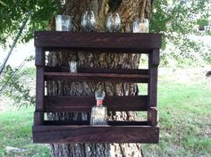 Repurposed pallet wine rack stained dark cherry. Bottom shelf large enough to hold wine or alcohol bottles. Top shelf can hold wine or beer glasses. I also added a small shelf in the middle to display average size to tall shot glasses. I have two large d-ring holders on the back so it is ready to be hung on your wall.