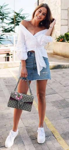 how to wear a denim skirt : bag + sneakers + white off shoulder top