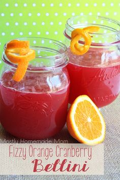 Fizzy Orange Cranberry Bellini - Such an easy non-alcoholic drink! Cranberry juice and orange juice with a splash of fizzy lemon sparkling water, even the kids love it!