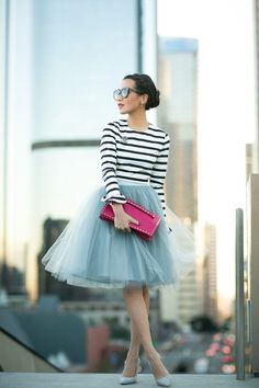 Tulle skirt with matching pumps! Keeping it casual with a striped shirt and a bright-colored clutch.