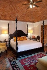 San Miguel de Allende Vacation Rental By Owner. The elegant master suite with boveda ceiling and handmade Portuguese-style bed