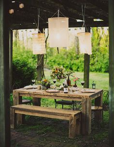 love these hanging lamps above a tablescape