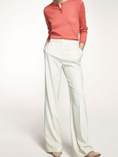 Wide-leg ecru trousers made from a delicate blend of fabrics. Straight cut, zip fly and hook-and-eye fastening, two side pockets, two welt pockets in the back and belt loops.