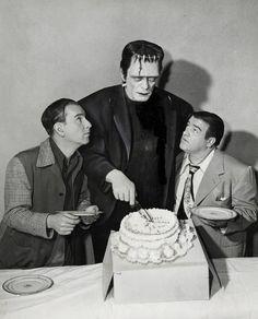 Birthday boy Glenn Strange (as Frankenstein monster) shares his cake with Abbott & Costello.