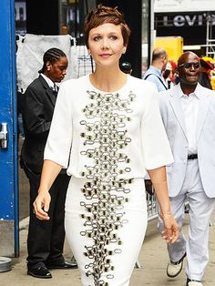 Star Tracks: Friday, August 1, 2014 | BUZZWORTHY | Maggie Gyllenhaal, in a honeycomb pattern embellished dress, leaves Good Morning America at ABC Times Square Studios in New York City on Thursday, where she talked about her new role in The Honorable Woman.