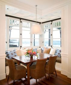 L-shaped breakfast nook with tropical décor and wicker chairs