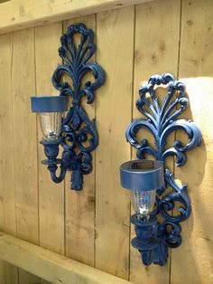 Vintage sconces upcycled into outdoor solar lights.