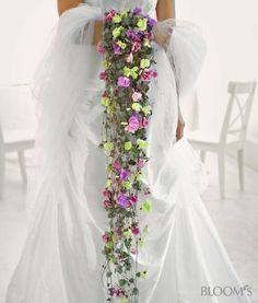 That's a waterfall bouquet! Made of pinks and Hearts on a String (Ceropegia linearis ssp. Wedding Flower Design, Floral Wedding, Peacock Wedding, Bouquet Bride, Bridesmaid Bouquet, Cascading Wedding Bouquets, Bridal Flowers, Grey Purple Wedding, Alternative Bouquet