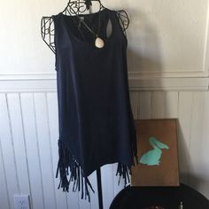 """Francesca's NWT Boho tank w/ fringe This Francesca's NWT tank has a slight high low hem and scoop neck, the sides are cut about 6"""" higher on both sides & lined with fringe! Super cool! Boho even if it is navy! Francesca's Collections Tops Tank Tops"""
