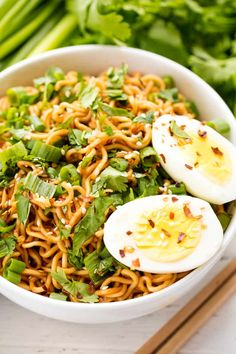 Ramen noodles are flavored with a sriracha-spiced sauce and served up with soft boiled eggs, cilantro, and green onions. All in just 15 minutes!