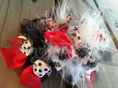 Wild About Minnie Bow ~ Aproximately 5 inches ~ Adorned with lots of prints, sparkle, crystals and feathers ~ Hand made with love, top quality materials and exceptional craftsmanship ~ To see more visit www.facebook.com/BizzyBodiesBowBoutique