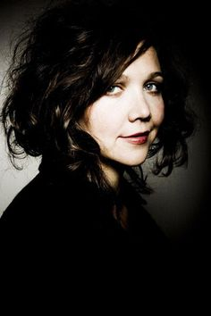 Maggie Gyllenhaal. Always intriguing.  I soooo love her hair here!  Maggie beautiful as always