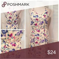 """Floral dress New without tags gorgeous floral sundress. Fully lined and string tie belt. Brand is Peach Love California (Nordstrom Rack). Size Medium: 18.5"""" UA, 36""""L. Dresses Mini"""