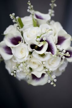 The 'Picasso' calla lilies in this shower bouquet are just so unusual, with their purple centers. If you'd like to use dainty lily of the valley at your wedding, you need to know that it has very limited availability. Also known as convallaria majalis, it's generally in season for the months of April and May only. Kate Middleton's bouquet was made up entirely of lily of the valley when she married William last April.