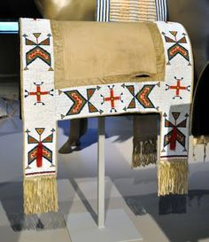 As promised, here are some more photos from the Native American saddlery collection at the Denver Art Museum. This woman's saddle was create. Native American Horses, Native American Regalia, Native American Artifacts, Native American Beadwork, Native American Fashion, American Indian Crafts, Horse Mask, Indian Horses, Saddle Blanket
