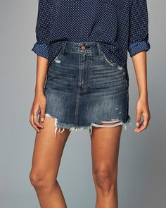 A feminine take on all-cotton denim with a classic A-line silhouette accented…