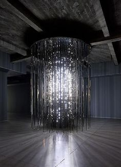 Cylinder . 2011  White LEDs . mirror finished stainless steel . custom software . electrical hardware  12 x 9 x 9 feet