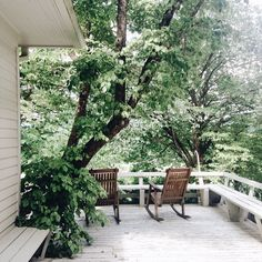 Wow! This porch is stunning. I love the white washed wood of the porch mixed with the raw wood of the rocking chairs. Plus, who wouldn't love that view?