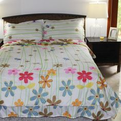 Girls Comforter Set - Daisy White - Kids Style  Add a pop of color to any girl's room with this bright kids' bedding. This Daisy bedding for girls features an all-over floral print in a variety of warm bright hues. This high quality 95 GSM super soft microfiber set comes with a comforter, coordinating sham(s) and bed skirt. It's machine washable for easy care.