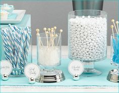 winter wonderland wedding dessert candy buffet. I like yhe light blue rable runners and decoration. So bright, and contrasts the white well