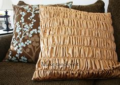 This gathered pillow tutorial is fantastic. Step-by-step instructions with pics. There are tons of other great tutorials on this site too!