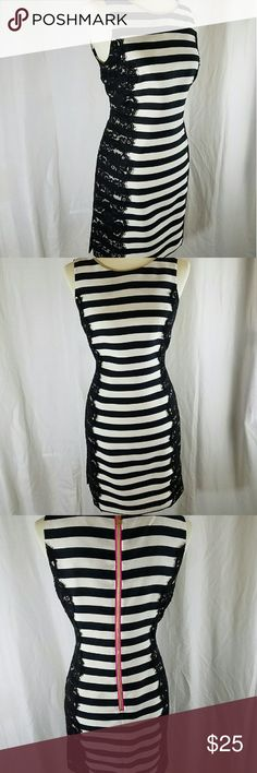 Eliza j dress size 6 ivovry with  black stipes In excellent condition dry cleaned only beautiful classy dress fully lined back zipper with detailed in pink  aide slips. Eliza J Dresses Asymmetrical