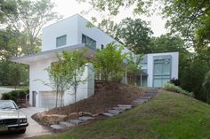 The 4600 square foot house accomodates the needs of a couple who desired a modern space to grow their family and entertain guests. The house respects the fabric of the historic neighborhood by matchin...