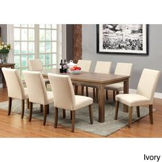 This textured replicated wood grain in light oak finished dining table gives a Transitional Style. The straight lines of the table work well with the chair's slight curves. The Chairs has two color options: Ivory fabric and Dark brown leatherette.