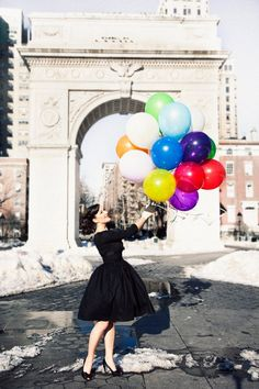 I want to take a picture like this just like Audrey Hepburn in a little black dress and big bright balloons :)