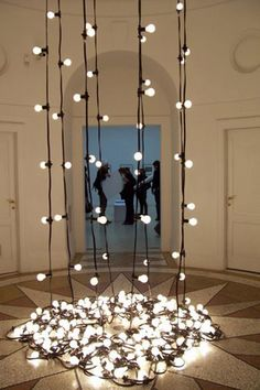 Peacefulness-weight  The lights hold themselves up. They project an image of self sustaining strength and lightness.  felix gonzalez-torres
