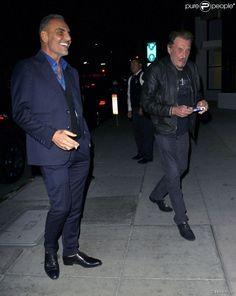 Johnny Hallyday et Christian Audigier lors d'un dîner au restaurant Mr Chow à Los Angeles le 23 janvier 2015