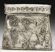 Viking Artifacts | silver pouch amulet or kaptorga . At top is a necklace made of ...