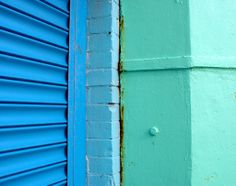 Green wall and blue roller shutters, with some rust showing. Located on Brighton sea front. Brighton Sea, Ancient Myths, Roller Shutters, Aquamarine Stone, Colour Board, Color Mixing, Blue Green, Wall, Design