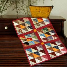 Cheddar Triangles Table Topper by PetitQuilts on Etsy, $54.00