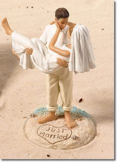 532864daeb21a4 Just Married Beach Couple Cake Topper. This cake top shows a groom carrying  his bride on a sandy beach with just married written in the sand