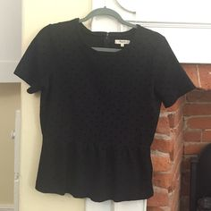 Madewell black polka dot peplum Cute subtle polka dots on this subtle peplum top from Madewell. Short sleeves with thicker fabric for fall and winter. Zipper goes half way down the back. Simply adorable. Madewell Tops Tees - Short Sleeve
